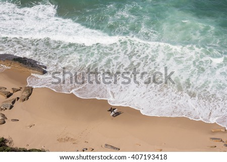 surfers on the beach top view - stock photo