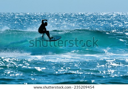 SURFERS PARADISE, AUS - OCT 14 2014: Surfer surfing in Main beach.It's a very popular surfing beach in Surfers Paradise Gold Coast Queensland, Australia. - stock photo