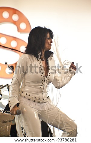 "SURFERS PARADISE, QUEENSLAND, AUSTRALIA - JAN 7: An unidentified singer (dressed like Elvis Presley) performs during the ""Surfers Paradise Elvis Birthday Bash"" concert on January 7, 2011 in Surfers Paradise, Queensland, Australia - stock photo"