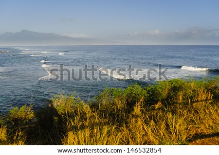 Surfing at sunrise on Hookipa State Park Beach, Maui, Hawaii, USA