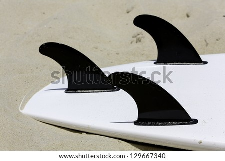Surfing board on the beach - stock photo