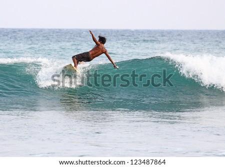 Surfing in Mirissa, Sri Lanka - stock photo
