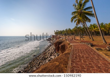 Surfing in the Indian Ocean near the town of Varkala - stock photo