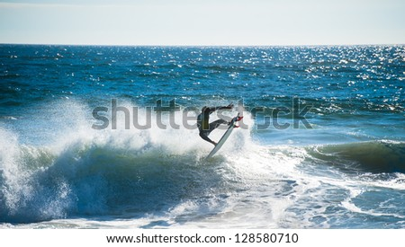 Surfing in wild waters at Valparaiso, Chile - stock photo