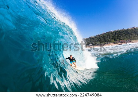 Surfing Inside Hollow Blue Wave Surfing surfer tube rides inside large hollow blue water ocean wave