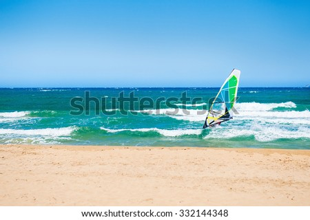 Surfing on the sea coast. Tropical beach with turquoise water. Crete island, Greece.  - stock photo