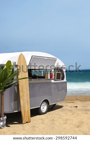 Surfing slow food truck caravan on the beach, vertical template with copy space - stock photo