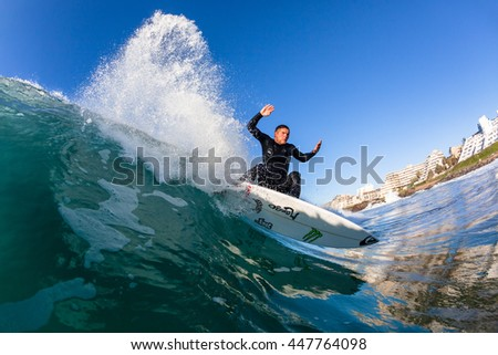 Surfing Surfer Water Action Ballito Bay, South-Africa - July 3, 2016 : Surfing surfer wave inside water swimming action photo.