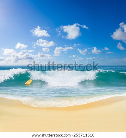 Surfing the indian ocean in Bali Indonesia - stock photo