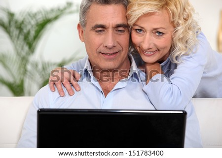Surfing the Internet together - stock photo