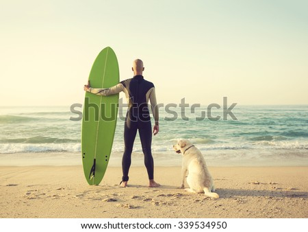 Surfist on the beach with his best friend