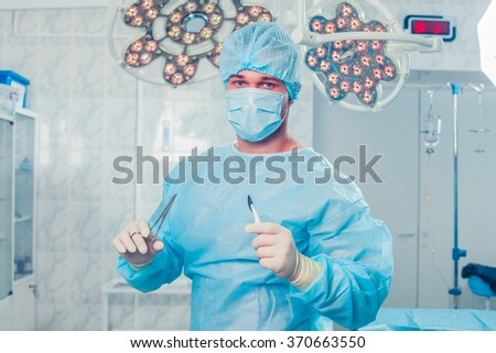 Surgeon at operating room in the hospital - stock photo