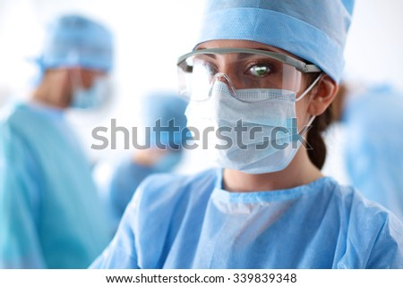 Surgeon in uniform close-up ready to step - stock photo