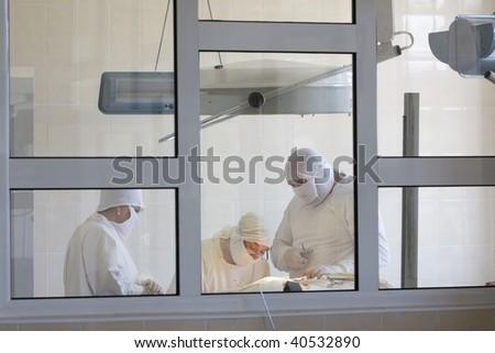 surgeon team at work - stock photo