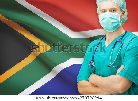 Surgeon with national flag on background - South Africa - stock photo