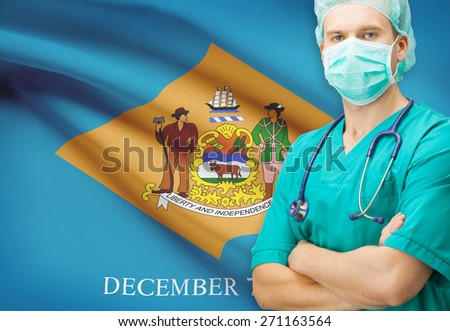 Surgeon with US state flag on background - Delaware - stock photo