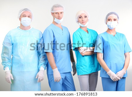 Surgeons standing on grey background