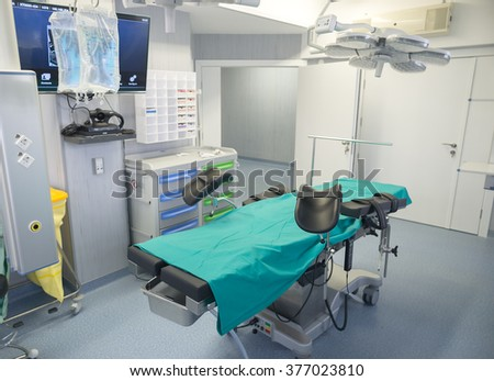 Surgery room with operation bed and modern equipment in an urology clinic for cancer treatment and overall medical intervention in oncology hospital, Sofia, Bulgaria, February 04, 2016.