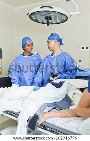 Surgery with operating table, nurse and surgeon