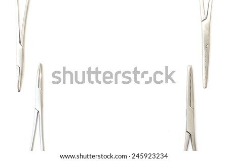 surgical clamps on a white background  - stock photo