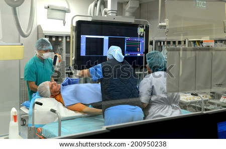 Surgical team operating on patient in hospital Sofia, Bulgaria March 11, 2014