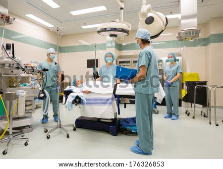 Surgical team preparing for sugery in operating theater