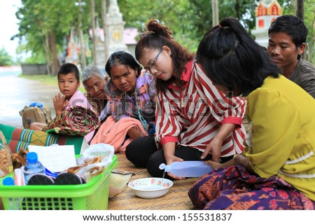 Surin, THAILAND - September 18 : people are making merits for their cousins who passed away on September 18, 2013 in Surin, Thailand