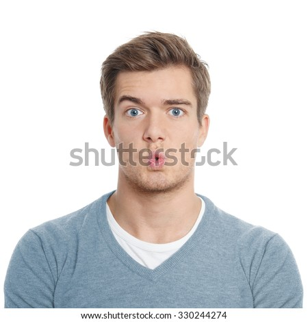surpised young man with funny facial expression - stock photo