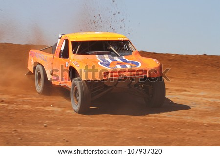 SURPRISE, AZ - APR 16: Adrian Cenni (11) at speed in Pro 4 Unlimited Lucas Oil Off Road Series racing on April 16, 2011 at Speedworld Off Road Park in Surprise, AZ. - stock photo