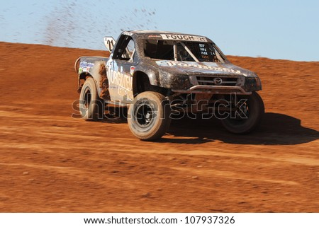 SURPRISE, AZ - APR 16: Brent Fouch (21) at speed in Super Lite Class Lucas Oil Off Road Series racing on April 16, 2011 at Speedworld Off Road Park in Surprise, AZ.
