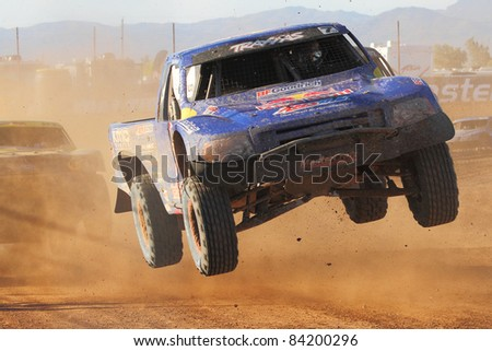 SURPRISE, AZ - APR 16: Bryce Menzies (7) over a big jump during Pro 2 Unlimited Lucas Oil Off Road Series racing on April 16, 2011 at Speedworld Off Road Park in Surprise, AZ. - stock photo
