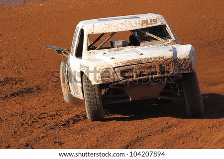 SURPRISE, AZ - APR 16: Corey Sisler (19) at speed in Lucas Oil Off Road Series Pro Lite Unlimited racing on April 16, 2011 at Speedworld Off Road Park in Surprise, AZ. - stock photo
