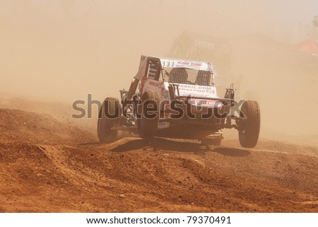 SURPRISE, AZ - APR 16: Greg Crew (337) at speed in round 3 action of Lucas Oil Off Road Series Limited Buggy racing on April 16, 2011 at Speedworld Off Road Park in Surprise, AZ. - stock photo