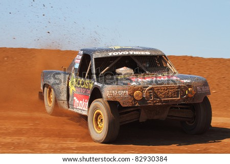 SURPRISE, AZ - APR 16: Kyle LeDuc (99) at speed in Pro 4 Unlimited Lucas Oil Off Road Series racing on April 16, 2011 at Speedworld Off Road Park in Surprise, AZ. - stock photo