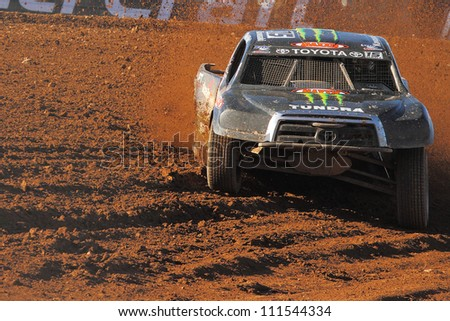 SURPRISE, AZ - APR 16: Marty Hart (15) at speed in Pro 2 Unlimited Lucas Oil Off Road Series racing on April 16, 2011 at Speedworld Off Road Park in Surprise, AZ. - stock photo