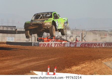 SURPRISE, AZ - APR 16: Nick Tyree (91) flys over a big jump in Pro 2 Unlimited Lucas Oil Off Road Series racing on April 16, 2011 at Speedworld Off Road Park in Surprise, AZ. - stock photo