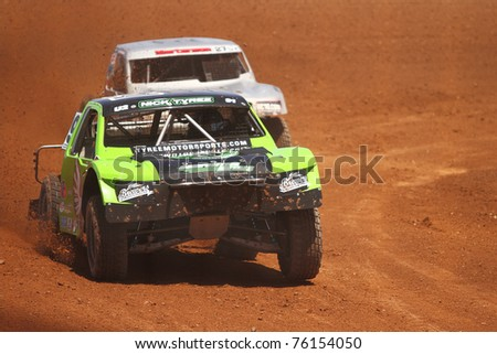 SURPRISE, AZ - APR 15: Nick Tyree (91) leads Scott Martenson (27) in a practice session for Lucas Oil Off Road Series racing on April 15, 2011 at Speedworld Off Road Park in Avondale, AZ. - stock photo