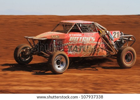 SURPRISE, AZ - APR 16: Pat Dean (21) at speed in Pro Buggy Unlimited Lucas Oil Off Road Series racing on April 16, 2011 at Speedworld Off Road Park in Surprise, AZ. - stock photo