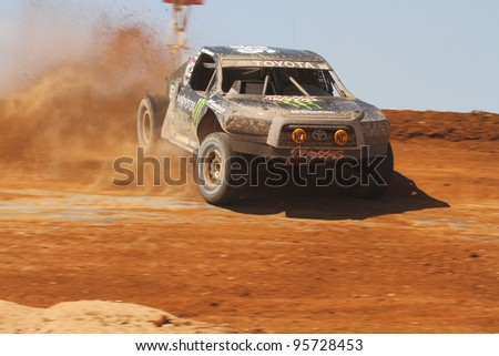 SURPRISE, AZ - APR 16: Rick Huseman (36) at speed in Pro 4 Unlimited Lucas Oil Off Road Series racing on April 16, 2011 at Speedworld Off Road Park in Surprise, AZ. - stock photo