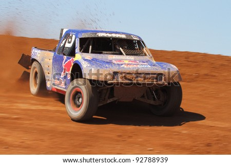 SURPRISE, AZ - APR 16: Ricky Johnson (48) at speed in Pro 4 Unlimited Lucas Oil Off Road Series racing on April 16, 2011 at Speedworld Off Road Park in Surprise, AZ. - stock photo