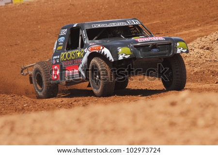 SURPRISE, AZ - MAY 18: Brian Deegan (38) at speed in Lucas Oil Off Road Series racing Pro Lite Unlimited practice on May 18, 2012 at Speedworld Off Road Park in Surprise, AZ. - stock photo
