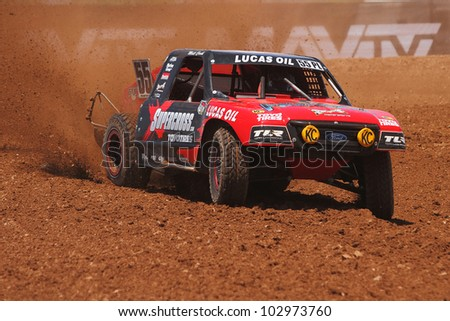 SURPRISE, AZ - MAY 18: Matt Cook (55) at speed in Lucas Oil Off Road Series racing Pro Lite Unlimited practice on May 18, 2012 at Speedworld Off Road Park in Surprise, AZ. - stock photo
