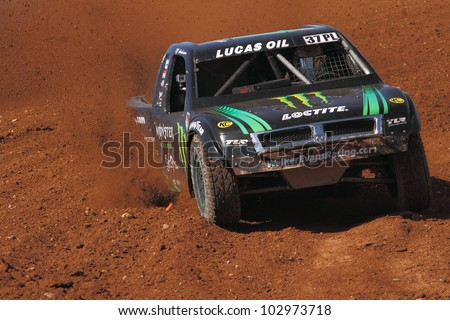 SURPRISE, AZ - MAY 18: RJ Anderson (37) at speed in Lucas Oil Off Road Series racing Pro 4 Unlimited qualifying on May 18, 2012 at Speedworld Off Road Park in Surprise, AZ. - stock photo