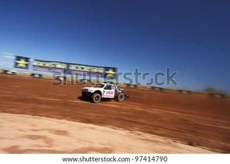 SURPRISE, AZ - SEP 23: Carl Renezeder (17) at speed in Pro 4 Unlimited Lucas Oil Off Road Series practice on Sept. 23, 2011 at Speedworld Off Road Park in Surprise, AZ. - stock photo
