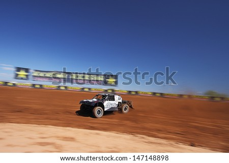 SURPRISE, AZ - SEP 23: Josh Merrell (22) at speed in Pro 4 Unlimited Lucas Oil Off Road Series practice on Sept. 23, 2011 at Speedworld Off Road Park in Surprise, AZ. - stock photo