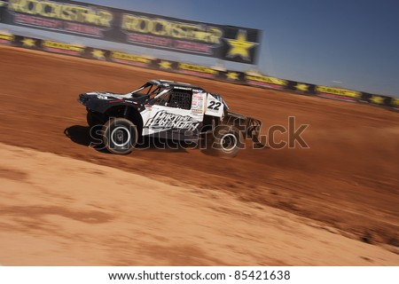SURPRISE, AZ - SEPT 24: Josh Merrell (22) at speed in Pro 4 Unlimited practice for Lucas Oil Off Road Series racing on Sept. 24, 2011 at Speedworld Off Road Park in Surprise, AZ. - stock photo