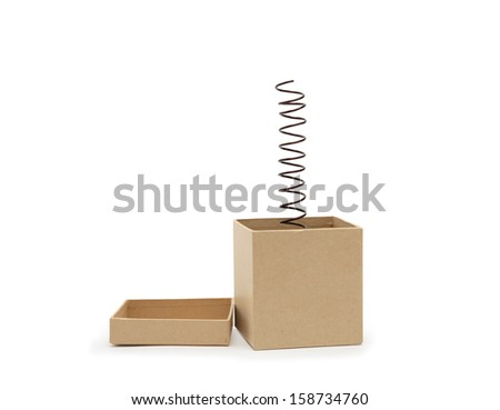 Surprise concept. Metal spring jumping from cardboard box. Clipping path is included - stock photo