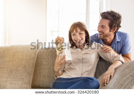 Surprise for you my love. Gift, sofa, home, girlfriend, couple - stock photo