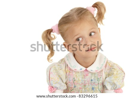 Surprise little girl with two tails wearing a dress on a white background