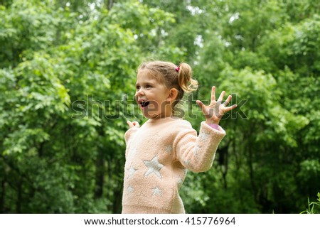 Surprise! Portrait of a little girl surprised outdoor.  - stock photo